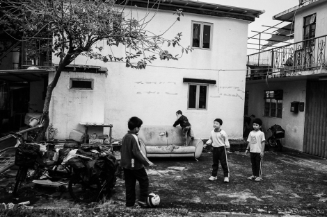 Children and a makeshift soccer pitch.