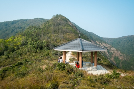 Taking a break at a pavilion before tackling Sai Wan Shan mountain (behind).