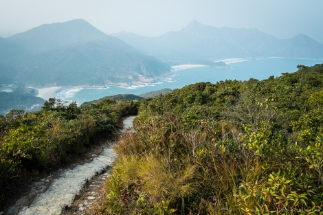 Descending the other side, a view of Tai Long Wan bay and beaches below.
