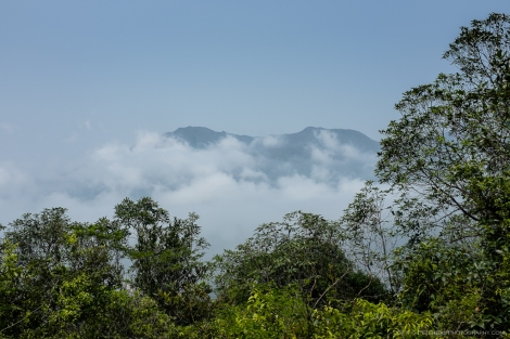 Low clouds and a view of Tai Tung Shan and Yi Tung Shan peaks in the distance.